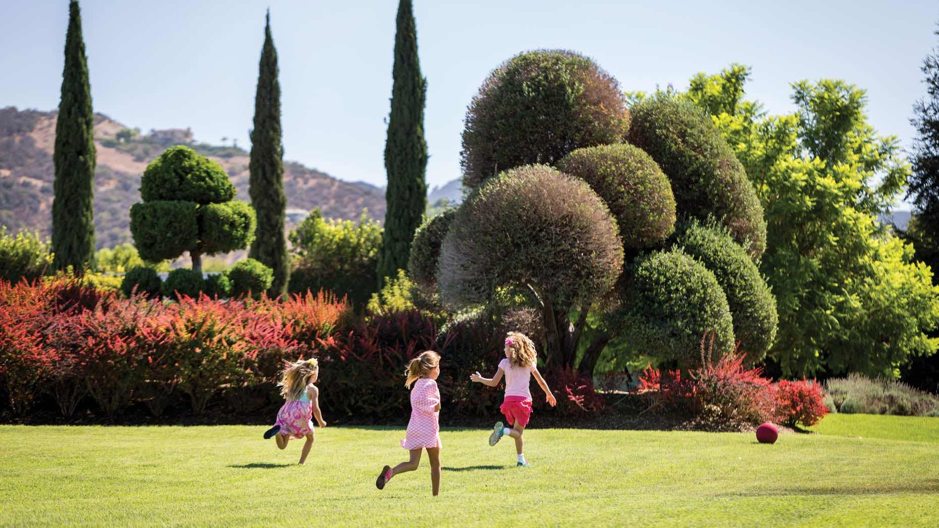 Kids playing in the gardens at Four Seasons Westlake Village as part of the best things to di in Westlake Village